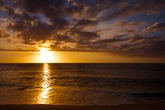 Beautiful tropical sunset at Kaanapali Beach in Maui Hawaii. Beautiful, warm tropical sunset on the white sands of Kaanapali Beach in Maui, Hawaii. A fabulous royalty free stock images
