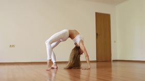 Beautiful girl doing stretching, warming up in empty gym stock footage