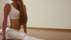 Beautiful girl doing stretching, sitting on the twine stock video