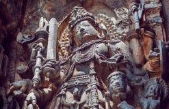 Beautiful warrior Shiva Lord on ancient relief of 12th centur Hoysaleshwara temple in Halebidu, India. Stock Photos