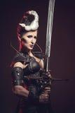 Beautiful warrior woman. Fantasy fighter. Stock Image