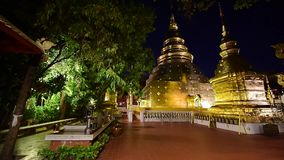 Night scene Wat Phra Singh timelapse, Chiang mai, Thailand. Beautiful Wat Phra Singh temple the very most famous temple at twilight, Chiang Mai, Thailand stock video