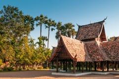 Beautiful Wat Ton Kwen wooden pavillion, Chiang Mai , Thailand. Beautiful architecture of Wat Ton Kwen wooden pavillion with palm tree, Chiang Mai , Thailand Royalty Free Stock Image