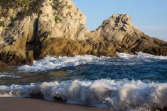 Beautiful Water. Photo of sunset rock formation at Tangolunda bay in Huatulco Mexico Royalty Free Stock Image