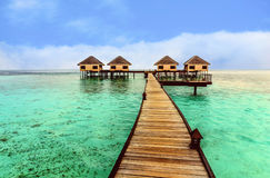 Beautiful water bungalows and the beach in Maldives Stock Photos
