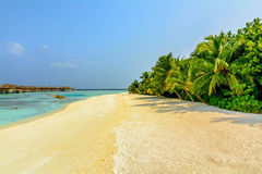 Beautiful water bungalows and the beach in Maldives Stock Photo