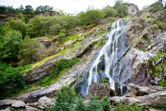 Beautiful water cascade of Powerscourt Waterfall, the highest waterfall in Ireland. Famous tourist atractions in co