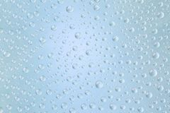 Beautiful water droplets of regular shape on frosted glass.  stock images