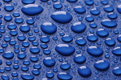 Beautiful water drops on blue Stock Photo
