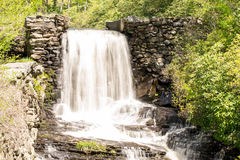 Beautiful water fall. A water fall in slow motion with the water looking a milky white Stock Photo
