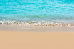 Beautiful water of the sea. And yellow sand stock photos