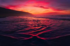 Beautiful water textures at sunset in Barinatxe beach in Sopelan Stock Image