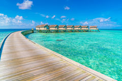 Beautiful water villas in tropical Maldives island  . Royalty Free Stock Image