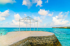 Beautiful water villas in tropical Maldives island at the sunris Royalty Free Stock Images