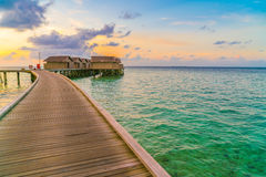 Beautiful water villas in tropical Maldives island at the sunset Stock Image