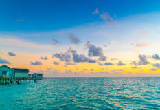 Beautiful water villas in tropical Maldives island at the sunset Royalty Free Stock Photography