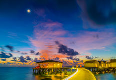 Beautiful water villas in tropical Maldives island at the sunset Stock Photography