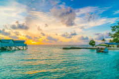 Beautiful water villas in tropical Maldives island at the sunset Stock Photo