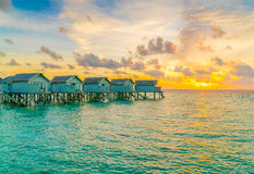 Beautiful water villas in tropical Maldives island at the sunset Royalty Free Stock Image
