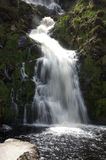 Beautiful Waterfall. Scenic view of a beautiful flowing waterfall royalty free stock images