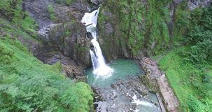 Beautiful Waterfall in the Alps, fresh Clear Water and green Lake. stock video
