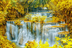 Beautiful  waterfall in autumn forest with ray light. Beautiful  waterfall in autumn forest with ray light effect, leaves color changed by retouch Stock Photography