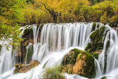 Beautiful waterfall  in autumn Stock Photos