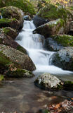 Beautiful waterfall and big rocks Stock Images