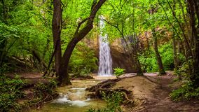 Beautiful Waterfall In Bright Green Forest. Fantastic scenery: beautiful small waterfall in bright green forest of the Crimea named Kozyrek making the shot very stock footage