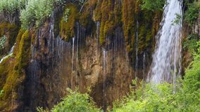 Beautiful waterfall cascades flow down over cliff stock footage