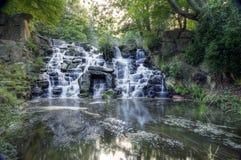 Beautiful waterfall cascades over rocks Royalty Free Stock Photos