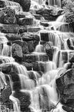 Beautiful waterfall cascades over rocks in forest Royalty Free Stock Photos