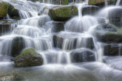 Beautiful waterfall cascades over rocks in forest
