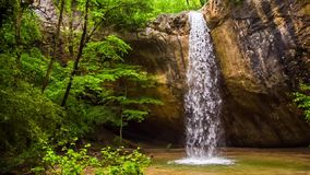 Beautiful Waterfall In Crimea Forest. This is a scenic view of one of the most beautiful waterfall called Kozyrek (Kobalar) falling off the rock into the small stock video footage