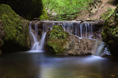 Beautiful waterfall deep in the forest Stock Photography
