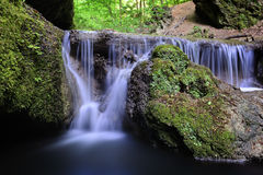 Beautiful waterfall deep in the forest Royalty Free Stock Photos