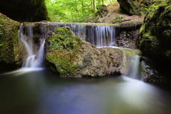 Beautiful waterfall deep in the forest Stock Photos