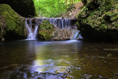 Beautiful waterfall deep in the forest Royalty Free Stock Photo
