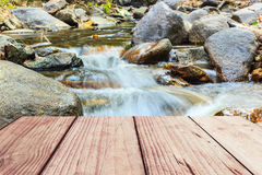 Beautiful waterfall in deep forest and wood pier Royalty Free Stock Photography