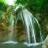 The beautiful waterfall Djur Djur in forest Royalty Free Stock Image