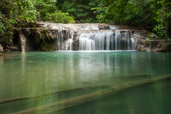 Beautiful waterfall falling in clear pond Royalty Free Stock Photo