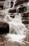Beautiful waterfall falling Stock Images