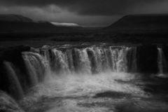 A beautiful waterfall in a field shot in black and white stock photography