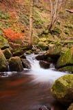 Beautiful waterfall flowing through Autumn Fall vibrant landscap Stock Photo