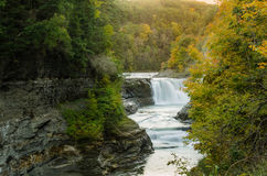 Beautiful Waterfall at the Foot of a Deep Forested Gorge. Beautiful Lower Falls at the Foot of a Deep Forested Gorge in Letchworth State Park, NY, in Autumn Stock Photography