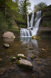 Beautiful waterfall in the forest. And the river Royalty Free Stock Image