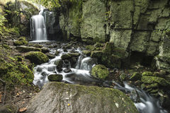 Beautiful waterfall in forest landscape long exposure flowing th royalty free stock photos