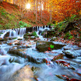 Beautiful waterfall in forest at sunset Royalty Free Stock Photos