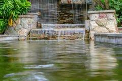 Beautiful waterfall in garden. The landscape of waterfall in garden stock photos