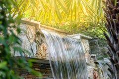 Beautiful waterfall in garden. Waterfall in garden with sun light stock photography